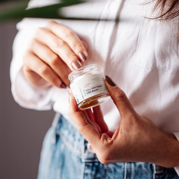 Woman with cbd balm